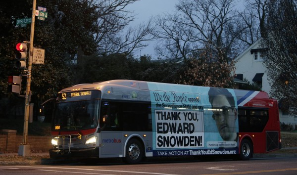 A Washington Metro bus is seen with an Edward Snowden sign on its side panel Dec. 20. A White House-appointed panel on Wednesday proposed curbs on some key National Security Agency surveillance operations, recommending limits on a program to collect records of billions of telephone calls and new tests before Washington spies on foreign leaders. Among the panel's proposals, made in the wake of revelations by former NSA contractor Edward Snowden, the most contentious may be its recommendation that the eavesdropping agency halt bulk collection of the phone call records, known as &quotmetadata.&quot