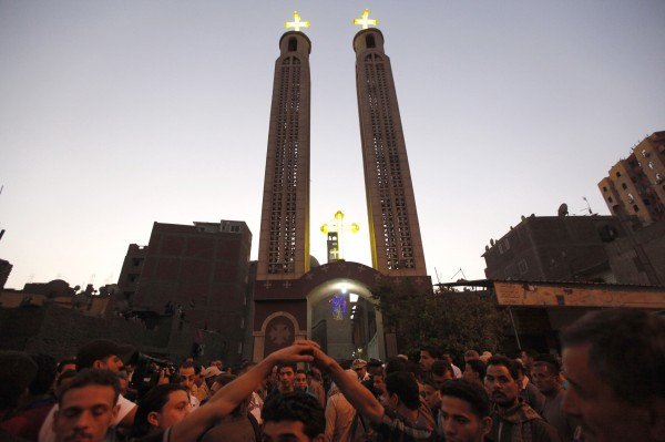 People gather at the Virgin Church for the funeral of four victims killed in an attack at a wedding on Sunday, in Cairo on Oct. 21.