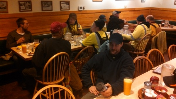 Members of tree-cutting crews, mostly from Western Massachusetts, fuel up on coffee, eggs and bacon at Dysart's Truck Stop in Hermon early Saturday morning. Crews were preparing to head to Hancock County to trim trees in hopes of restoring power to more than 3,700 homes and businesses in that county still without power on Saturday morning.