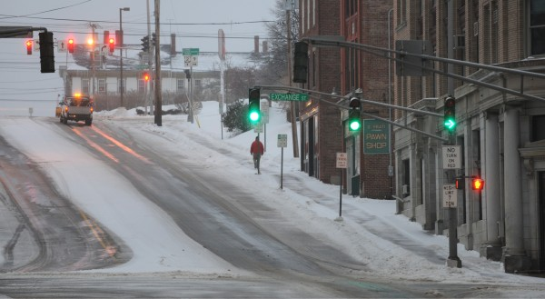 A pedestrians walks up State Street in downtown Bangor on Sunday morning.