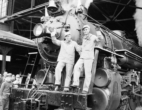 Governor Burton M. Cross, left, and E. Spencer Miller, president of Maine Central Railroad, wave from the front of Steam locomotive 470 at Union Station in Bangor in this June 1954 file photo.