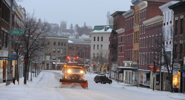 A snow plow clears snow from Main Street in downtown Bangor on Sunday morning.