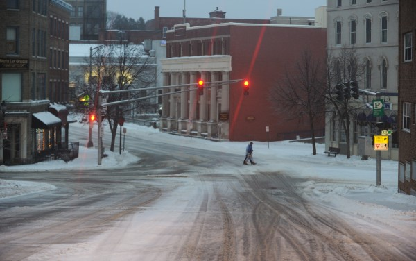 Pedestrians cross Hammond Street in downtown Bangor on Sunday morning.