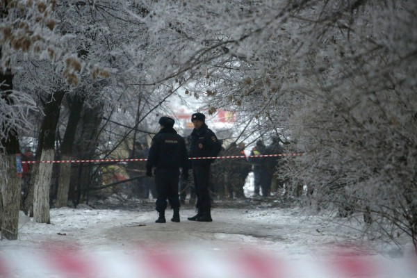 Police stand guard at the site of a blast on a trolley in Volgograd, Russia, on Monday. Russian President Vladimir Putin ordered law enforcement agencies to increase security in the southern city of Volgograd and nationwide after two deadly bombings hit the city, the Kremlin said.