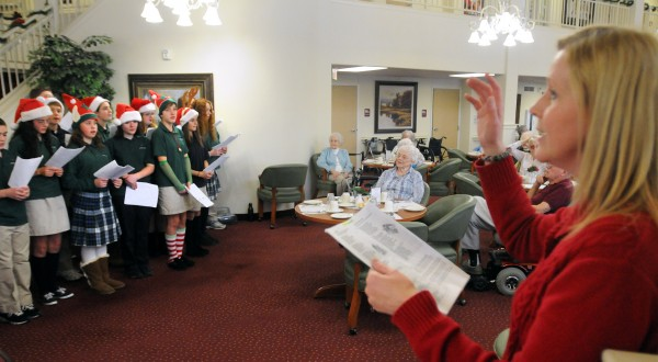 The All Saints Catholic School chorus sings Christmas carols for the residents of Winterberry Heights Assisted Living in Bangor in December 2012. A group of carolers in Washington, D.C., wound up being victims of crime when a someone stole their credit and debit cards while they were performing.