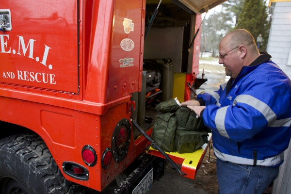 Justin Faloon, a member of DEEMI Search and Rescue, repacks a bag after a search for two lost hunters from Millinocket. While out searching for a missing Bangor man on Thanksgiving Day, Faloon ended up saving the life of a man who had overdosed at a Bangor convenience store.