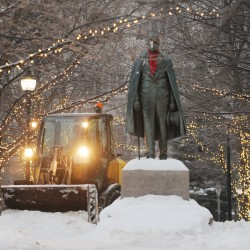 Bangor Public Works employee Bud Green operates snow removal equipment near the Hannibal Hamlin statue in downtown Bangor on Sunday morning.