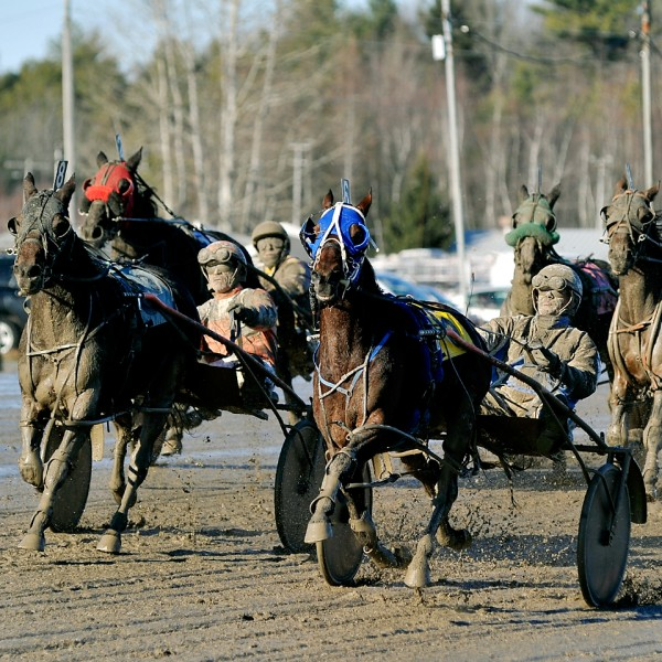 Hermon native Shawn Thayer (right) races to his 1,000th career driving victory during action at Scarborough Downs on Saturday.