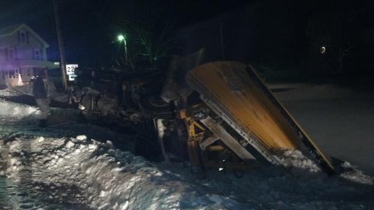 A Maine Department of Transportation truck went off the road as it was plowing snow and rolled over onto its side in Perham on Saturday night.