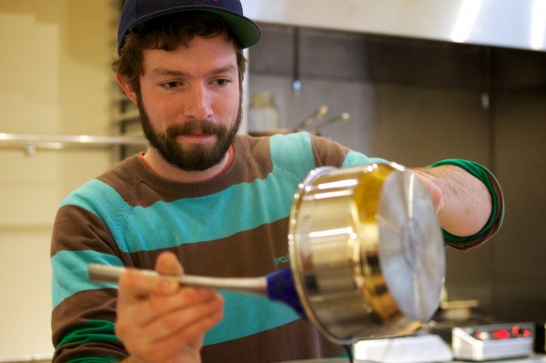 Vinland sous chef Ryan Quigley makes a blueberry and vinegar reduction on Monday in Portland.