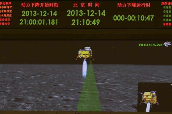 A photograph taken on a giant screen at the Beijing Aerospace Control Center in Beijing shows an animated image of the Chang'e-3 lunar probe descending onto the surface of the moon, Dec. 14, 2013.