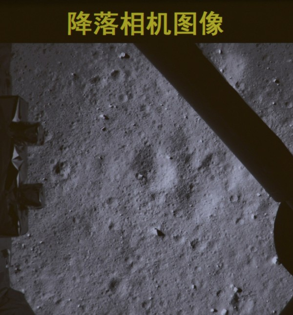 A photograph taken on a giant screen at the Beijing Aerospace Control Center in Beijing shows the footage taken by a camera on the bottom of Chang'e-3 lunar probe as it descends onto the surface of the moon, Dec. 14, 2013. China landed an unmanned spacecraft on the moon on Saturday, state media reported, in the first such &quotsoft-landing&quot since 1976, joining the United States and the former Soviet Union in managing to accomplish such a feat. The Chang'e 3, a probe named after a lunar goddess in traditional Chinese mythology, is carrying the solar-powered Yutu, or Jade Rabbit buggy, which will dig and conduct geological surveys.