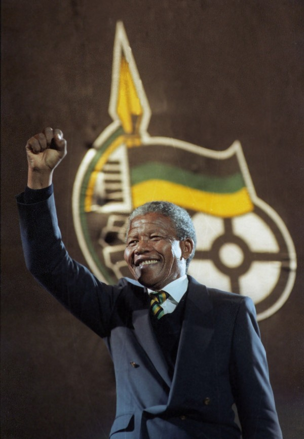 Nelson Mandela raises his fist as he walks on stage at Wembley Arena in London in this April 16, 1990 file photo. Mandela has passed away on December 5, 2013 at the age of 95.