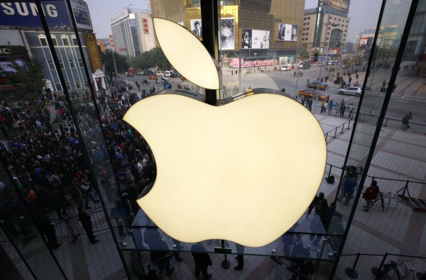 Members of the public enter a new Apple store during the official opening in Beijing's Wangfujing shopping district in this October 20, 2012, file photo.