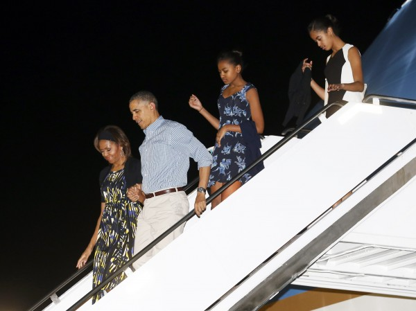 President Barack Obama and first lady Michelle Obama arrive in Hawaii with daughters Sasha and Malia on Friday for a two-week vacation.