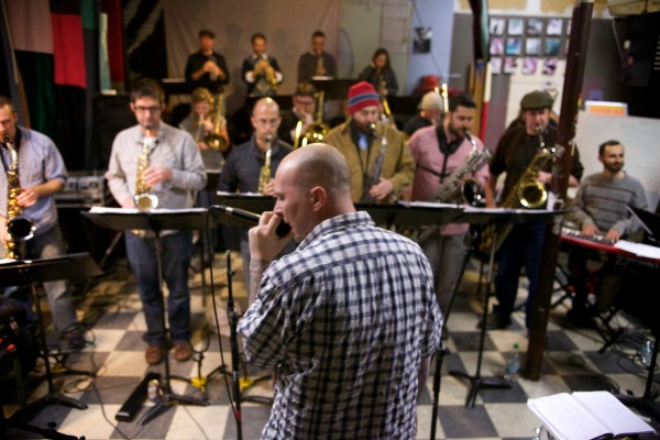 Rapper Bryan Eldridge, better known as Syn the Shaman, rehearses with the Fogcutters Big Band in Portland last week. Eldridge, and five other local performers, are appearing with the 19-piece band Dec. 6 at the State Theatre for the group's annual &quotBig Band Syndrome&quot show.