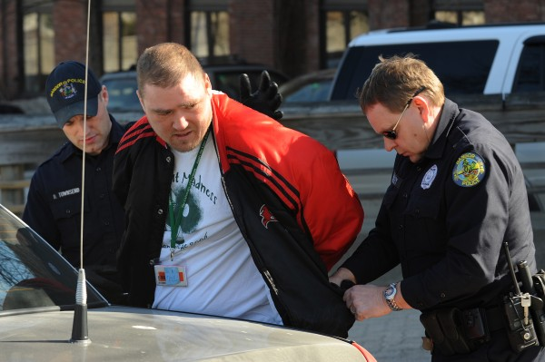Jason Dean of Bangor is arrested by Bangor police Officers Dennis Townsend (left) and Paul Colley on Franklin Street on March 16, 2009, in connection with a knife attack on a woman employed at Java Joe's on Central Street.