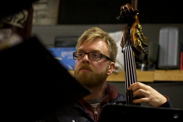 Bassist Adam Frederick, of the 19-piece Fogcutters Big Band, rehearses in Portland last week in preparation for the Dec. 6 show at the State Theatre.