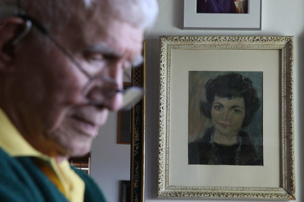 Alan Purdy, 88, shown with a painting of his late wife, Margaret, at their San Marcos, California home, told authorities that he did nothing to stop her as she committed suicide.