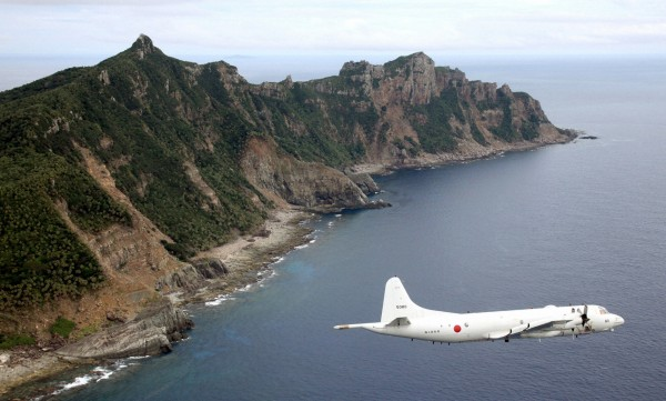 Japan Maritime Self-Defense Force's PC3 surveillance plane flies around the disputed islands in the East China Sea, known as the Senkaku isles in Japan and Diaoyu in China, in this October 13, 2011 file photo. Asian aviation officials on November 25 said airlines would have to inform China of flight plans before entering airspace over waters disputed with Japan, forcing carriers to acknowledge China's authority over a newly declared &quotAir Defense Identification Zone&quot. China published coordinates for the zone on the weekend. The area, about two-thirds the size of the United Kingdom, covers most of the East China Sea and the skies over a group of uninhabited islands at the centre of a bitter row between Beijing and Tokyo.