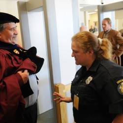 "<a href=""http://bangordailynews.com/2013/11/10/news/midcoast/degrees-of-change-prison-education-program-offers-new-beginnings-for-maine-inmates/?ref=search"">Thomas Abbot</a>, a dean at the University of Maine at Augusta, gets screened by corrections officer Angela Smith at the Maine State Prison Nov. 4 before graduation ceremonies for 14 inmates earning degrees from UMA."