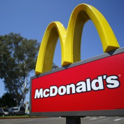 A McDonald's sign is shown at the entrance to one of the company's restaurants in Del Mar, California in this September 10, 2012, file photo. Credit: Reuters