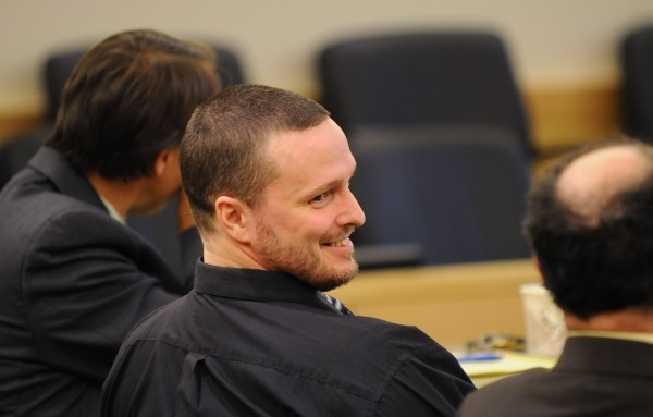 Jason Trickett smiles at his attorney Marvin Glazier during the verdict phase of his trial at the Penobscot  Judicial Center in Bangor in September. Trickett was found not guilty of manslaughter in the stabbing death of Andy Smith during a fight on First Street in May 2012.