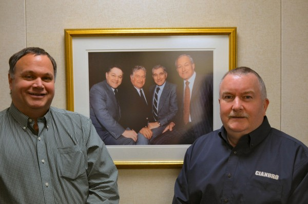 Charlie Cianchette, left, and his cousin, Mac Cianchette, far right, stand in front of a picture of the founders of Cianbro. From left to right in picture: Chuck, Carl, Ken and Bud. Chuck is Charlie's father, while Carl is Mac's father. Carl Cianchette co-chaired the first fundraising committee to build Sebasticook Valley Hospital in Pittsfield. His son, Mac, is the chair of the capital campaign committee for the SVH expansion.