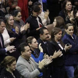 Mexican congressmen applaud after the Mexico Congress approves the biggest oil sector shake-up in the lower house in Mexico City December 12, 2013.