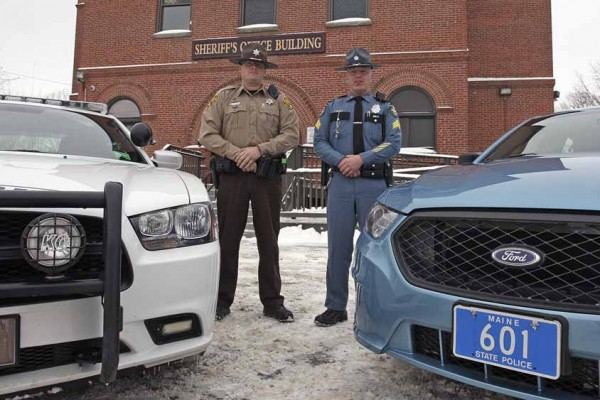 The Aroostook County Sheriff's Office and the Maine State Police are changing the way they patrol The County. In the past, The County was broken into five regions, but now both units will patrol all of Aroostook County on a daily basis. On the left is Deputy Vance Palmer of the Aroostook County Sheriff's Office, and Sgt. Brian Harris of the Maine State Police is on the right.