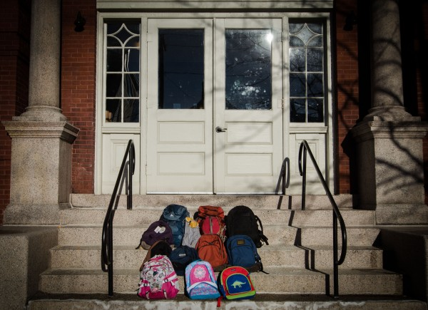 Frances Buerkens, director of Maine Citizens Against Handgun Violence, placed backpacks on the steps of the former Emerson School in Portland this week to remember the 20 children shot and killed at Sandy Hook Elementary School in Newtown, Conn., on Dec. 14, 2012.