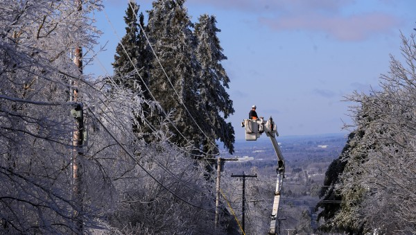 Gardiner-based On Target Utility Services crews were clearing power lines on the Wiswell Road in Holden while assisting Bangor Hydro in restoring power to many communities in area Wednesday, Christmas Day.