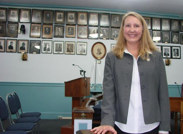 The Bath City Council chose Mari Eosco as its first chairwoman Wednesday. Behind her in the City Council Chambers is a gallery of the chairmen who have served since the 19th century.