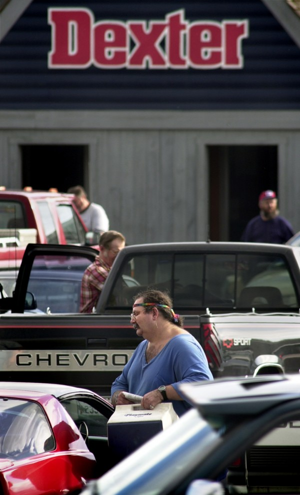 Employees of Dexter Shoe head to their cars at the end of the workday in 2001 during which they were notified that the factory was going to shut down.