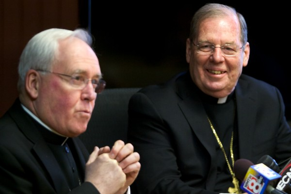 Bishop Richard J. Malone (left) introduces Bishop Peter Deeley, 67, at press conference in Portland on Wednesday. Deeley, an auxiliary bishop and canon lawyer in the Roman Catholic Archdiocese of Boston, has been named by Pope Francis to lead Maine's Catholics.