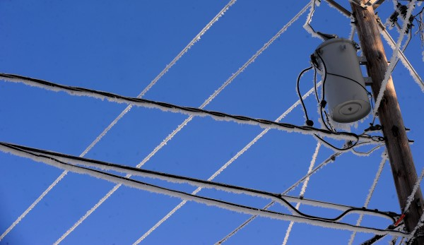 Ice covers power lines in Holden Wednesday, Christmas Day.