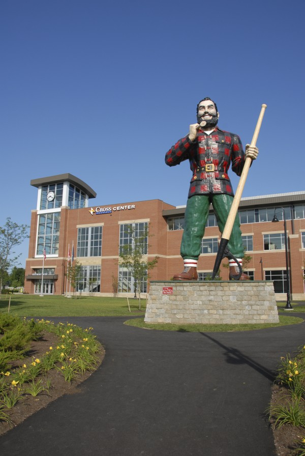 The Paul Bunyan statue stands near the new $65 million Cross Insurance Center on Main Street in Bangor.