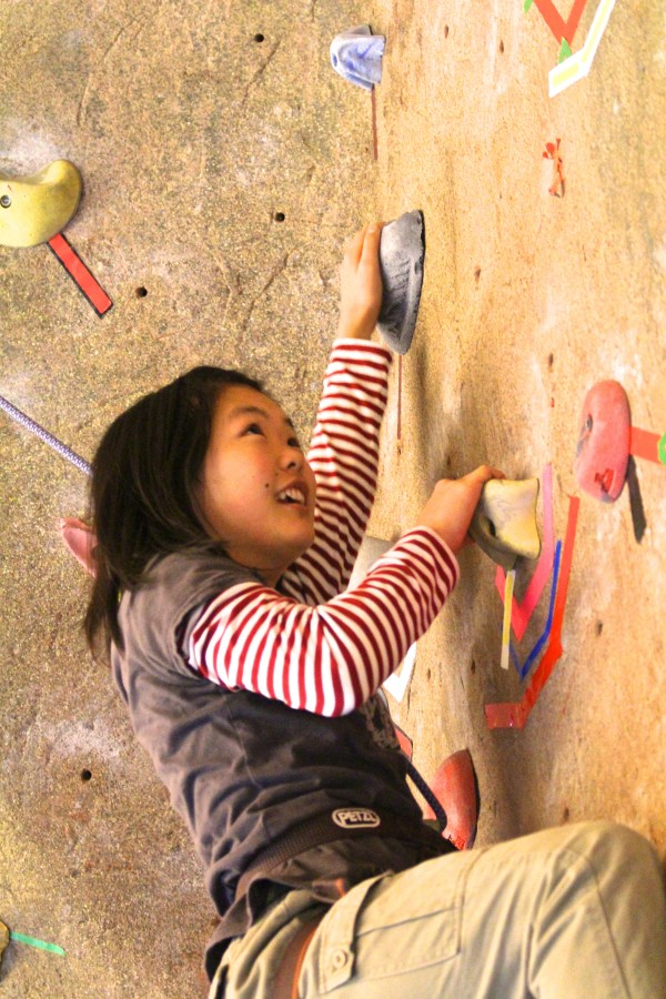 Yuna Shibata of Tokyo, an exchange student attending Bangor High School, rock climbs for the first time at Maine Bound Adventure Center during a Bangor High School Outing Club trip on Dec. 10, 2013, at the University of Maine in Orono.