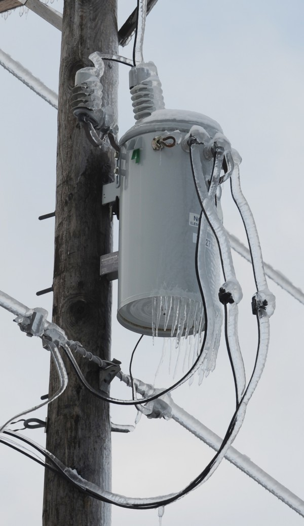 Ice coats a power transformer along Route 1A in Ellsworth on Saturday.