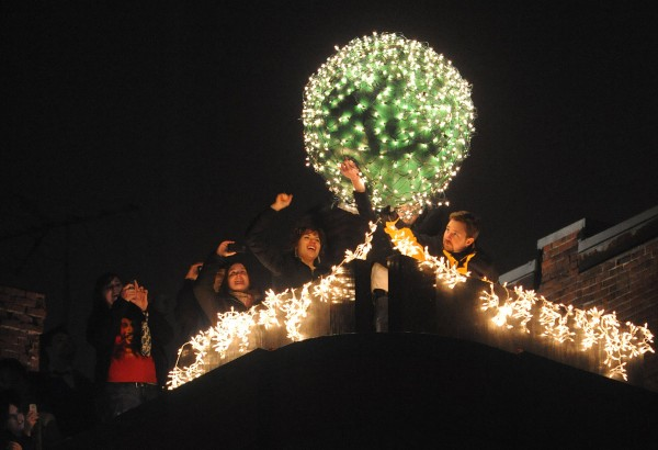 People lift the inflatable ball before throwing it off the top of Paddy Murphy's in downtown Bangor on Saturday, Dec. 31, 2011 to mark the beginning of 2012.