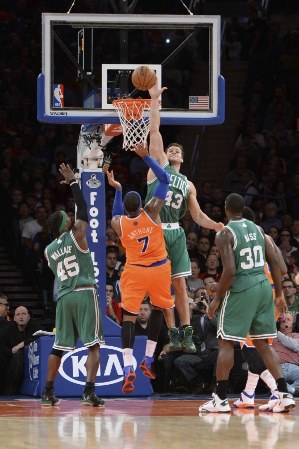 Boston Celtics power forward Kris Humphries (43) blocks a shot by New York Knicks small forward Carmelo Anthony (7) during the first half at Madison Square Garden in New York Sunday. The Celtics won the game 114-73.