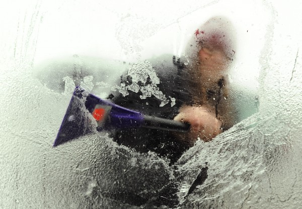 Tyla Crocker uses her lunch break from her job at  J.C. Penny's at the Bangor Mall to scrap the ice from her car windows on Sunday.