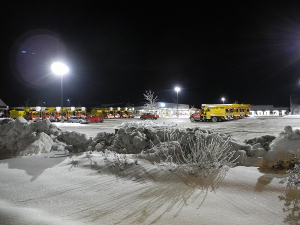 A fleet of bucket trucks lined up late Christmas night in Reny's Plaza in Belfast, with the temperature dipping to close to zero degrees. More than 450 line crews from all over the Eastern seaboard, from Florida to New Brunswick, came to Maine to help restore power lines damaged in the long ice storm.