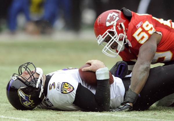 Baltimore Ravens quarterback Joe Flacco, left, lies on the turf after being sacked by Kansas City Chiefs linebacker Jovan Belcher during the first half of their AFC Wild Card NFL playoff football gamein this Jan. 9, 2011 file photo.