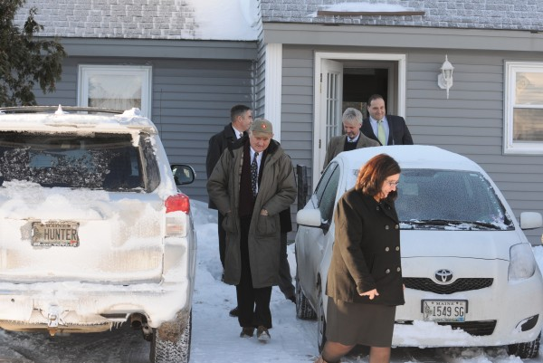 Assistant Attorney General Leanne Zainea (front to back), Justice Allen Hunter, Bangor detective Joel Nadeau, defense attorney David Bate and defense attorney Joseph Baldacci leave apartment No. 24 at 682 Ohio St. in Bangor on Monday after viewing the bathroom and surrounding area where the body of Rick Jeskey was found in June 2011.