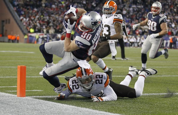New England Patriots wide receiver Danny Amendola (80) scores the winning touchdown as Cleveland Browns defensive back Buster Skrine (22) defends during the fourth quarter at Gillette Stadium. in Foxborough, Mass., Sunday.