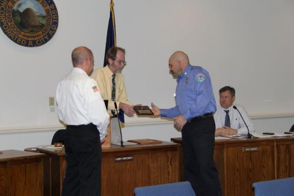 The Rockland City Council honored Lt. Rick Johnson Monday night for 20 years of service to the city of Rockland as a member of the Rockland Fire Department. Johnson received a plaque from Mayor Larry Pritchett as Chief Charles Jordan Jr. looked on.