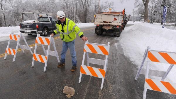 Bridge maintenance supervisor Jimi Differ puts a road block out near the Verona Island side of the Penobscot Narrows Bridge on Monday.