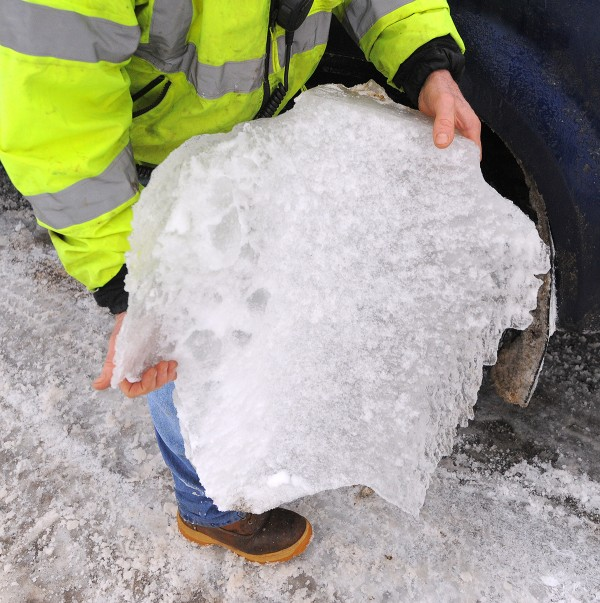 Bridge maintenance supervisor Jimi Differ holds a piece of ice that was on one of the support cables of the Penobscot Narrows Bridge on Monday.