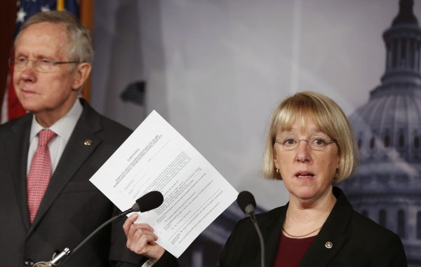 Senate Budget Committee chair Senator Patty Murray holds up a copy of a federal employees' Worker Adjustment and Retraining Notification (WARN) at a news conference on Capitol Hill in Washington in this February 28, 2013, file photo.